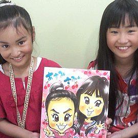 1枚の色紙に描いた女の子2人の似顔絵