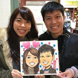 若い世代からも大好評の男性似顔絵師が描いたカップルの似顔絵