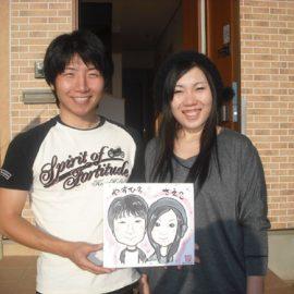 リアルタッチで描かれたご夫婦の似顔絵