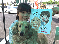似顔絵をお描きした女の子と愛犬