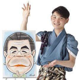 和装の男性似顔絵師